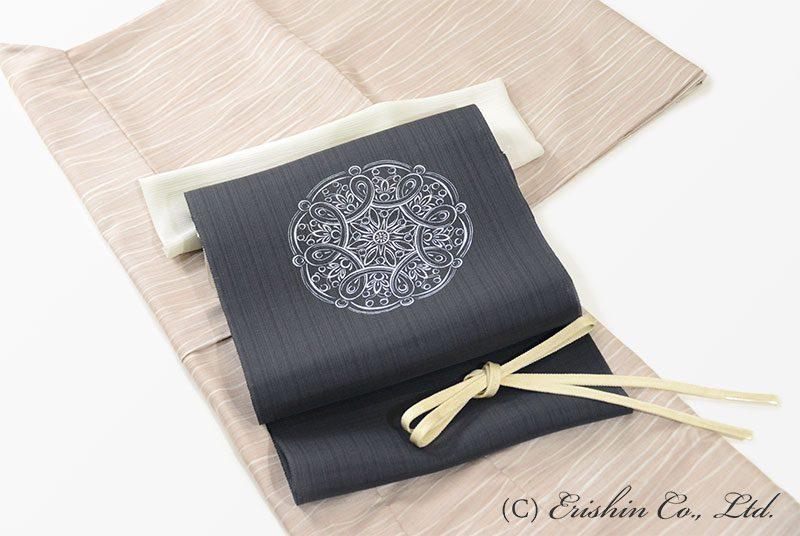 小紋(しけ引き蝋纈)と染名古屋帯(紗紬)