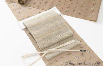 夏琉球絣(柴色)に夏八寸織名古屋帯(鎖織)