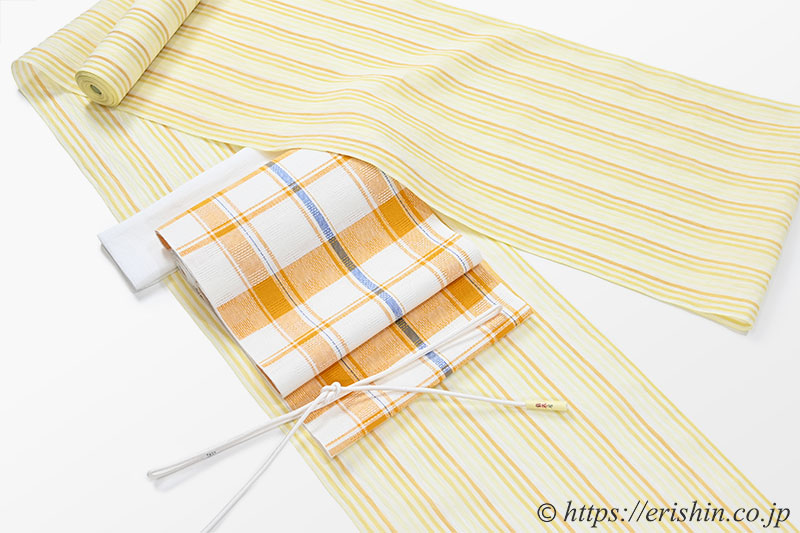小千谷縮(縦縞/蜂蜜色)広巾と八寸織名古屋帯(格子・柑子色/麻)[夏・単衣向]のコーディネート