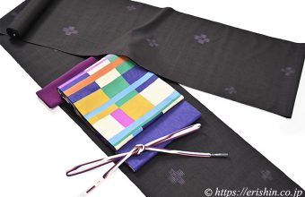 士乎路紬(飛び絣・弊店誂え)に風通織袋帯(綴れ段市松/木屋太)
