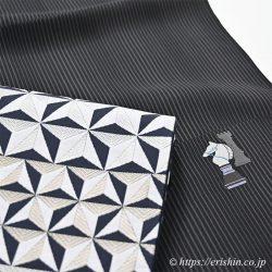木屋太 縫取御召着尺の「ナイトアンドルーク」柄と、袋帯「割付ダイヤ」柄。